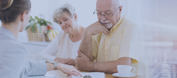 Family reviewing their finances with an advisor