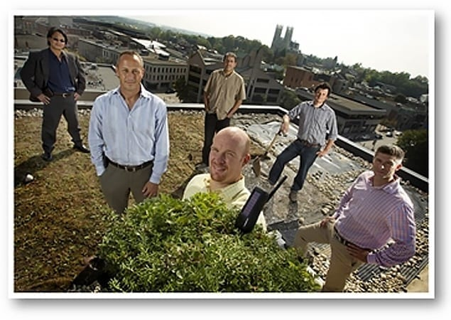 Skyline executive looking over roof-top project.