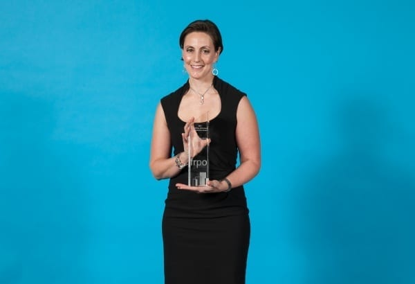 Winner Andrea Rocheleau poses after her win of Propety Manager of the Year