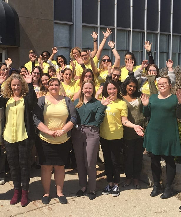 Twenty four employees of Skyline pose in front of the 70 Fountain Street location