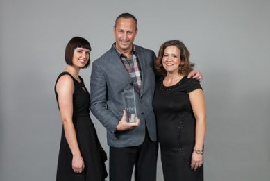 Skyline Co-Founder and Chief Sustainability Officer Roy Jason Ashdown accepts the Rental Development of the Year Award, with BJ Santavy, Director of Residential Operations (right), and Bethany Curtis, Marketing and Communications Assistant (left).